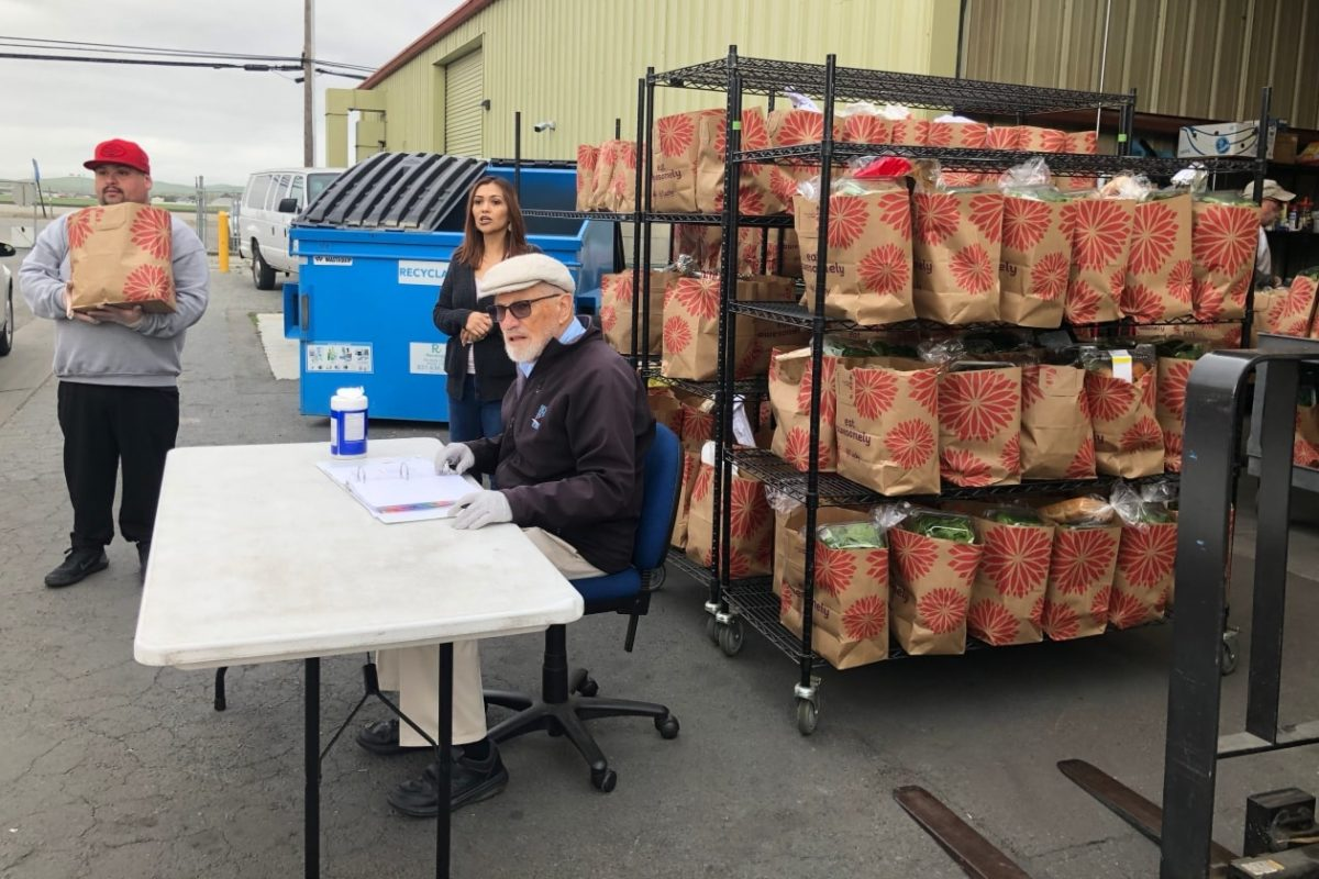 Volunteers outside at drive-thru grocery pick-up at Community FoodBank of San Benito County