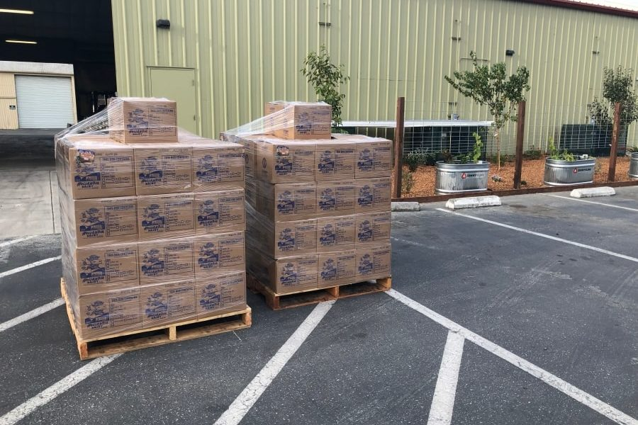 Pallets of USDA food delivered by Foodlink