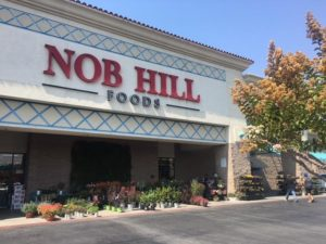 Front view of exterior of Nob Hill Foods grocery store in Hollister, CA