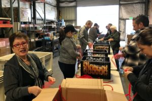 Volunteers packing student snack bags at Community Food Bank of San Benito County